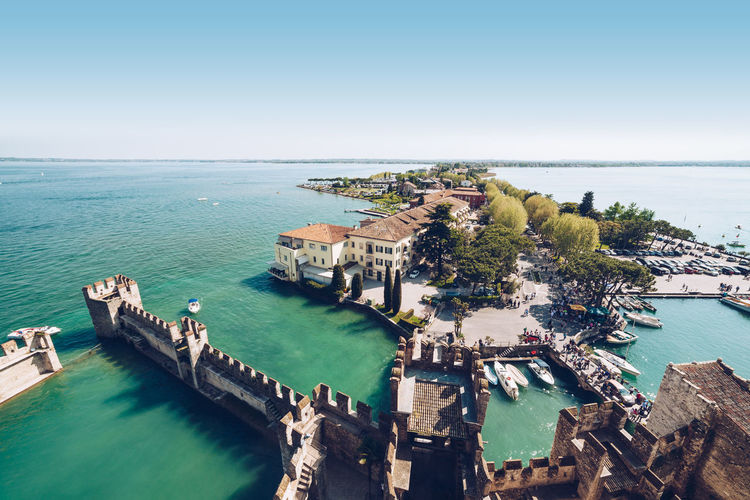 View of Sirmione - Travel destination and Famous tourist attractions in italy Aerial View Architecture Building Building Exterior Built Structure City Cityscape Day High Angle View Horizon Horizon Over Water Nature No People Outdoors Scenics - Nature Sea Sky Transportation Travel Travel Destinations Water