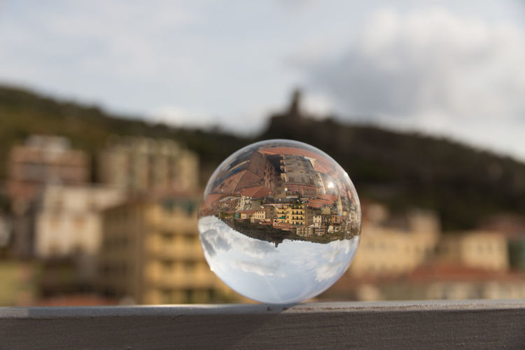 Cloudy Day Crystal Ball Holiday Sphere Architecture Building Exterior Built Structure Close-up Clouds And Sky Day Focus On Foreground No People Outdoors Reflection Sea And Sky Sky Spherical Photo