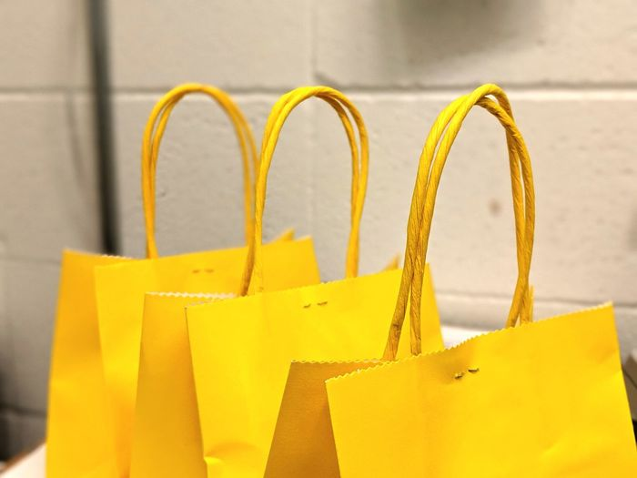 Shopping Cart Shopping Bag Gift Yellow Close-up Shop Prepared Food Market Stall Display Market Fish Market Raw Stall Flea Market Street Market Price Tag Assortment Retail Display Market Vendor Farmer Market Flower Market Ingot For Sale