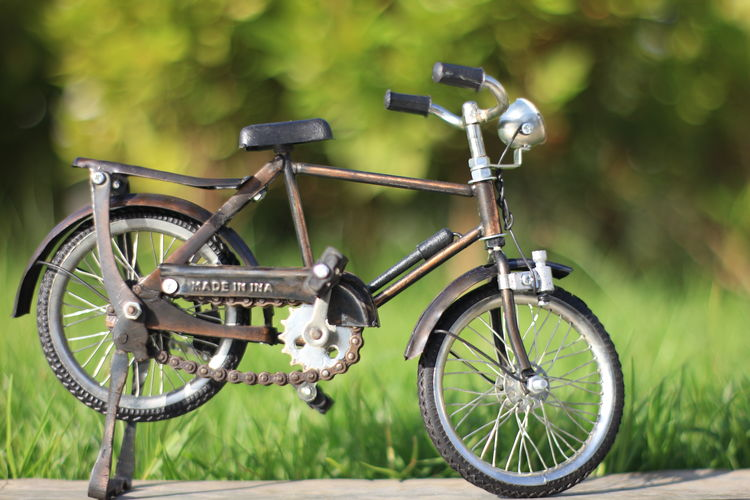 Aceh Transportation Mode Of Transportation Bicycle Land Vehicle Stationary Day No People Wheel Focus On Foreground Green Color Outdoors Plant Metal Travel Field Nature Close-up Land Selective Focus Tree Small
