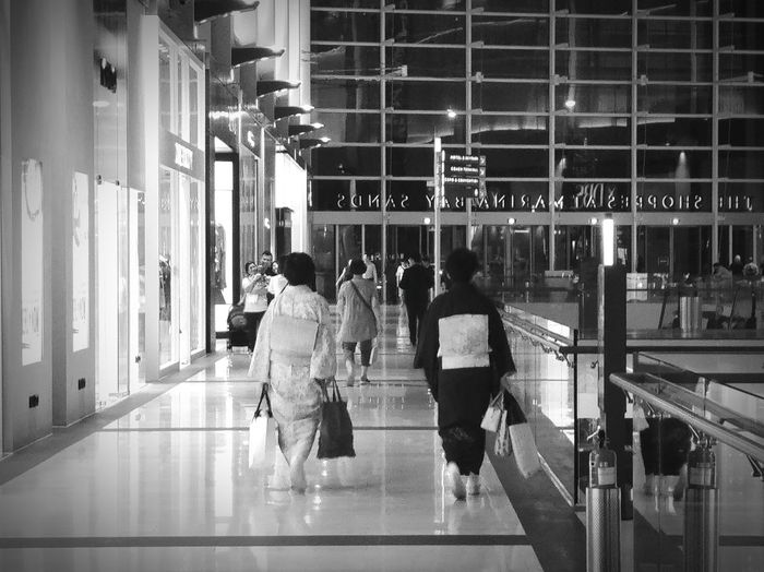 People walking in the shoppes at marina bay sands