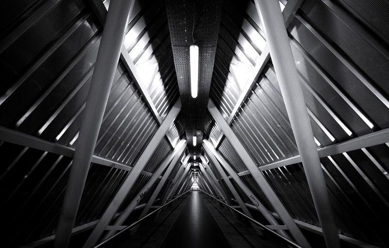 Empty covered illuminated walkway