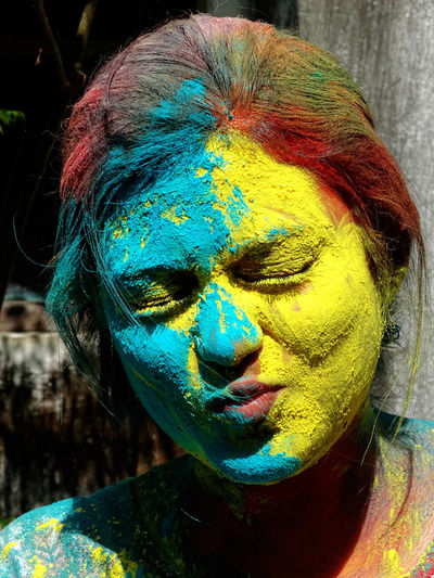 Close-up portrait of woman with powder paint