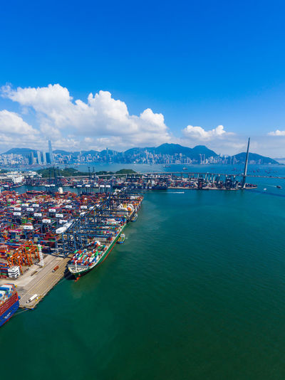 Hong Kong Cargo Terminal Hong Kong Port Logistics Shipping  Container International Business Export Ship Dock Trade Transport Freight Sea Containers Import Global Warehouse Customs Yard Crane Carrier Logistic Stack Distribution Commercial Storage Harbor Industrial Ocean Kwai Chung Kwai Chung City Top View Aerial Fly Drone  Over Above Down Top Down Panoramic Hk HongKong
