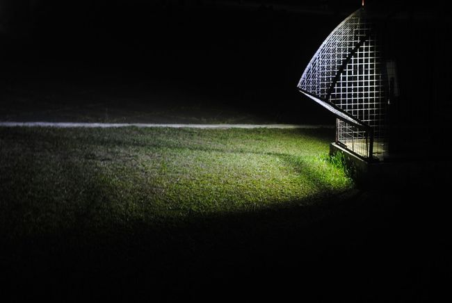 Night Darkness And Light Shadows & Lights Grass Fence Light Ray Shoots Man Made Outdoors No People Park Philippines Outdoor Photography Quezonmemorialcircle Quezoncity