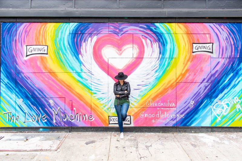 Hearts Graffiti Multi Colored Graffiti One Person Full Length Street Art Creativity Rear View Spray Paint Paint Wall - Building Feature Adult Standing Real People Mural Outdoors City Art And Craft Lifestyles