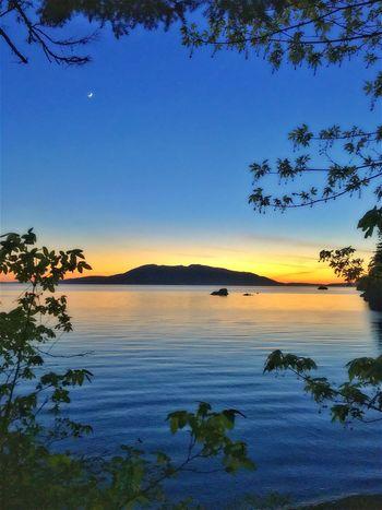 Sunset with moon over lake Sunset On Lake