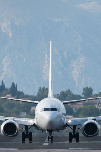 Airbus A320 on Corfu runway Aerospace Industry Aeroplane Ready Plane Corfu Greece Mountains Head On Turbine Plane Airfield Aircraft Airplane Wing Aeroplane Engine Aircraft Wing Runway