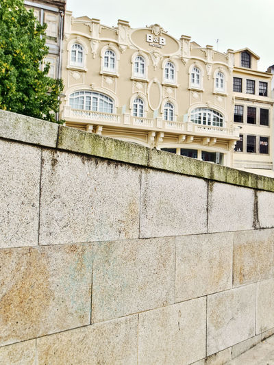 Oporto, Portugal Architecture Building Building Exterior Built Structure City Day Façade History In A Row Low Angle View Nature No People Outdoors Residential District Sky Stone Wall Sunlight Tree Wall Wall - Building Feature Window