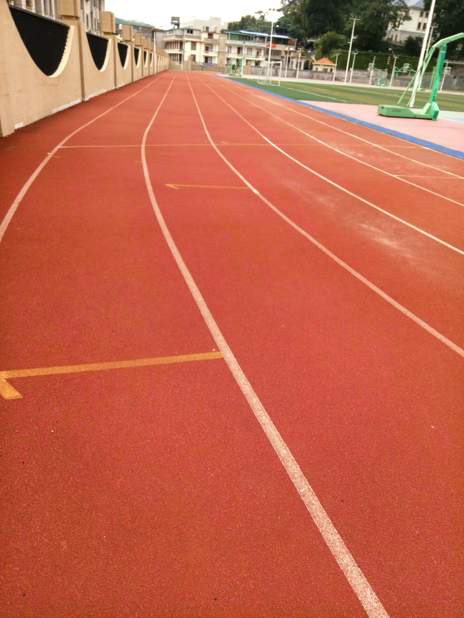 running track, track and field, sport, sports track, red, empty, competition, day, single line, track, playing field, outdoors, dividing line, diminishing perspective, no people, tranquility, tranquil scene, surface level