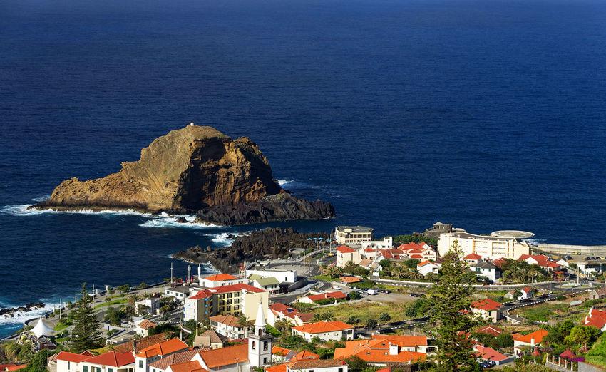 Built structures against calm blue sea