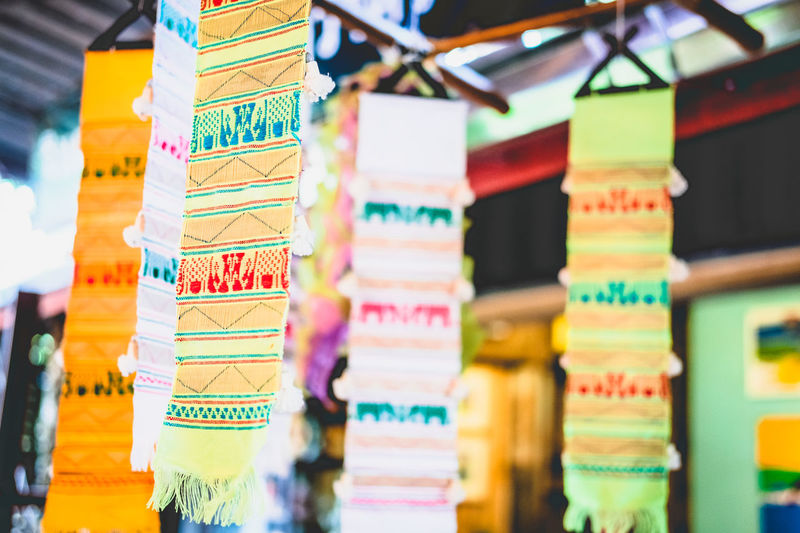 Business Choice Close-up Communication Day Focus On Foreground For Sale Hanging In A Row Large Group Of Objects Market Multi Colored No People Non-western Script Retail  Retail Display Script Selective Focus Stack Text Variation