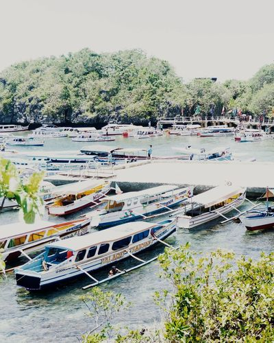 High angle view of boats moored in river