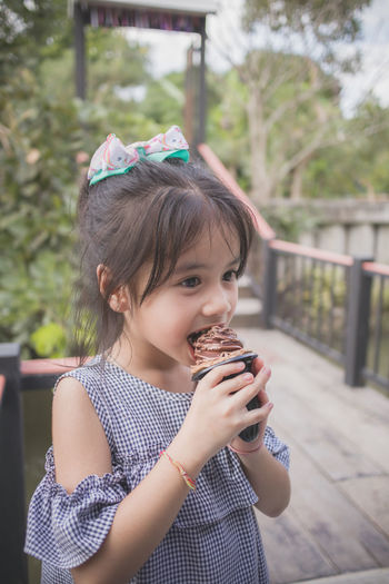 Portrait of a girl holding ice cream