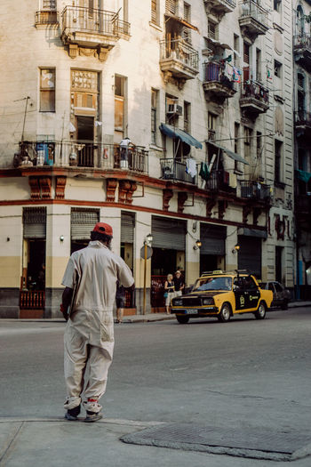 Been There. Cars Cuba Havana Taxi Adult Architecture Building Exterior Built Structure Cab Car Casual Clothing City City Life City Street Full Length Men One Person Rear View Street Streetphotography Transportation Travel Destinations Vintage Cars