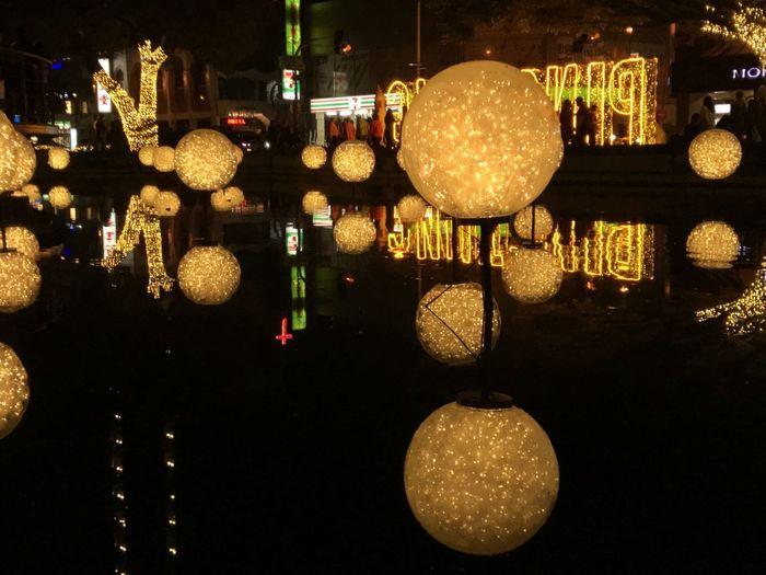 Close-up of illuminated christmas lights hanging at night