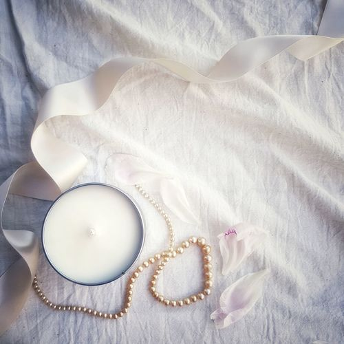 Candle petals & pearls Shabby Chic Vintage Crumpled Candle Soy Wax Candle Studio Shot Textile High Angle View Pastel Colored Close-up Fabric