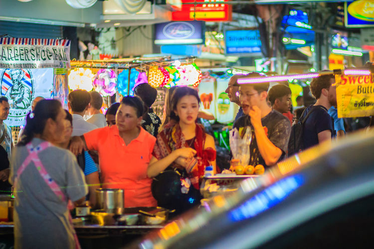 Bangkok, Thailand - March 2, 2017: Tourists and backpackers visited at Khao San Road night market. Khao San Road is a famous low budget hotels and guesthouses area in Bangkok. Khao San Rd Khao San Road KhaoSan Khaosan Rd. Khaosandroad Tourist Tourist Attraction  Tourists Adult Casual Clothing Child Childhood Food Food And Drink Fun Group Of People Illuminated Indoors  Khao San Khao San Knok Wua Khao San Rd. Khaosan Road Khaosanroad Leisure Activity Lifestyles Looking Men Night Market Night Market In Thailand Night Market, People Real People Retail  Selective Focus Togetherness Tourist Destination Women