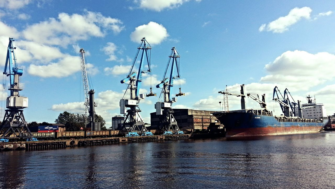 nautical vessel, transportation, harbor, sky, cloud - sky, freight transportation, mode of transport, commercial dock, water, shipping, crane - construction machinery, day, industry, waterfront, no people, moored, cargo container, outdoors, ship, sea, shipyard, nature