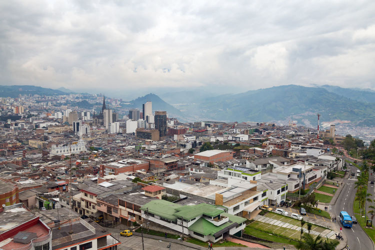 Late afternoon view of Manizales, Colombia. Andes Architecture City Cityscape Coffee Colombia Downtown Latin Manizales Nevado South Tourist View Aerial America Andean Caldas Coffee Triangle Colombian  Destination Landscape Mountain Sky Volcano Zone