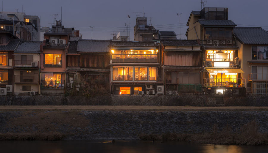 Old house and restaurant at Kamo river, Kyoto, Japan Illuminated Building Exterior Architecture Built Structure Night Water No People Building Nature Reflection City Dusk Sky Residential District Outdoors Lighting Equipment Transportation Waterfront River