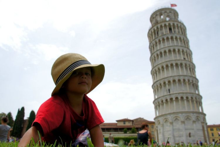 Boy by leaning tower of pisa