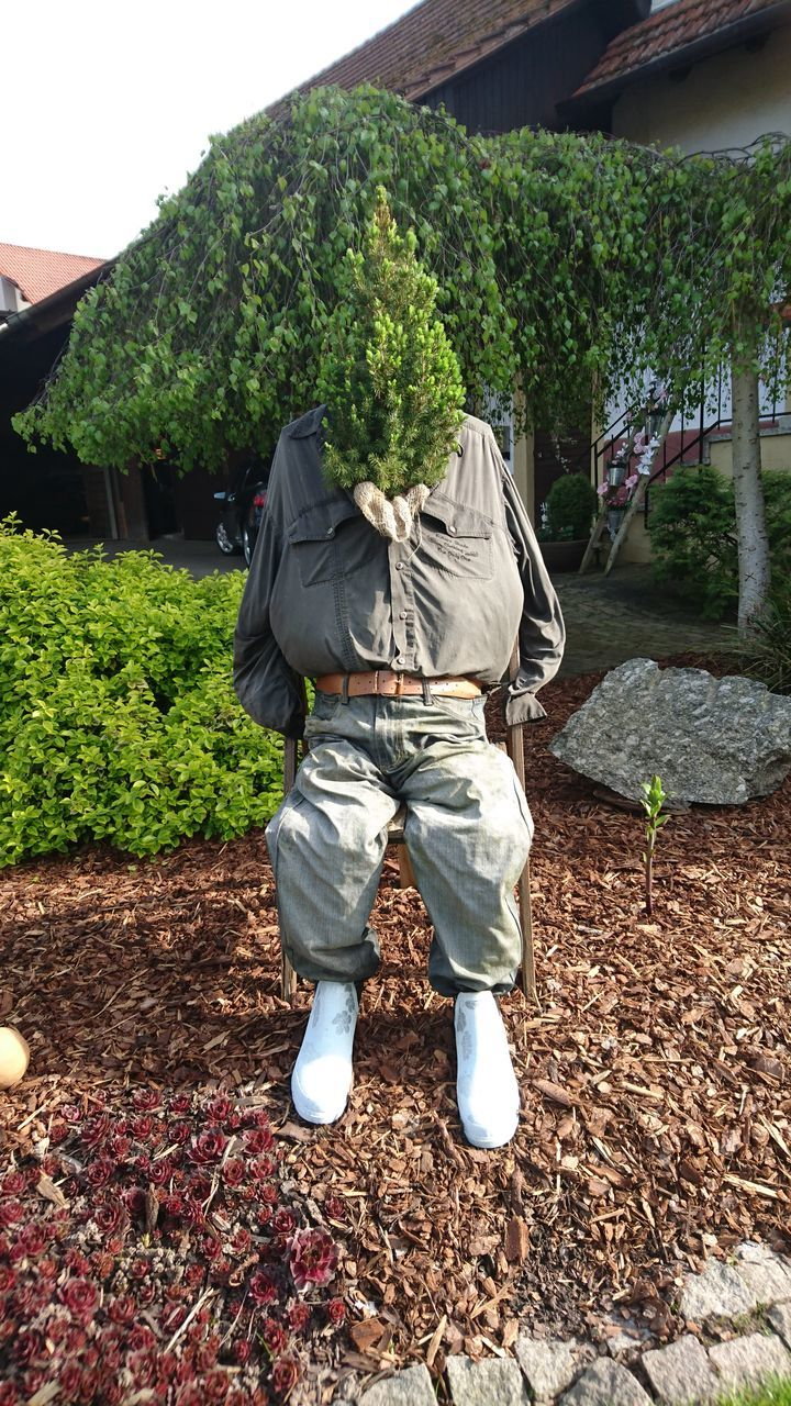 one person, tree, real people, rear view, growth, day, standing, field, men, outdoors, plant, nature, leaf, scarecrow, occupation, working, low section, young adult, people