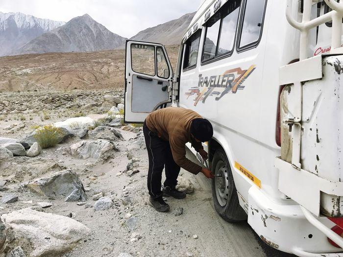 Man Repairing Motor Home On Road