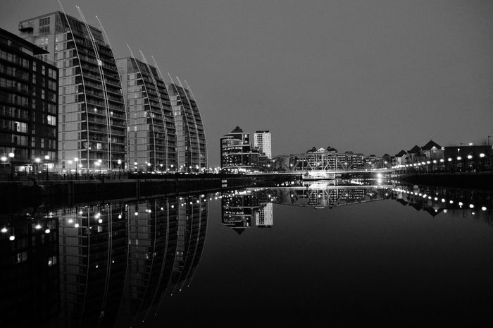 Reflection Architecture_collection Salford Quays Blackandwhite Urban Landscape Reflections In The Water Architecture Building Exterior Built Structure Reflection Illuminated Water EyeEm Ready   Nature Cityscape Symmetry Travel Destinations No People Outdoors Modern Sky Clear Sky Waterfront City Skyscraper Night