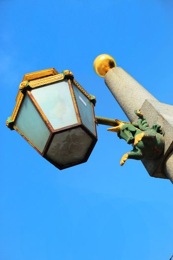 Low Angle View Of Unicorn Carving On Lamp Post Against Clear Sky