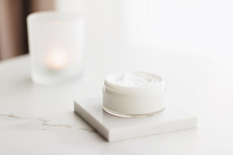 Close-up of moisturizer on white background