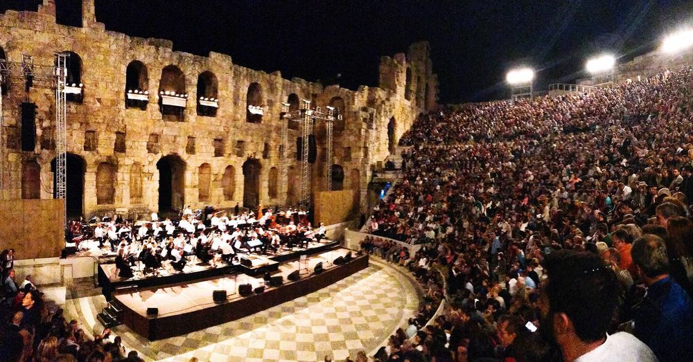 Large Group Of People Illuminated Architecture Real People Built Structure Night Building Exterior Leisure Activity Crowd Togetherness Lifestyles Outdoors People Theater Ancient Architecture Ancient Culture Ancient Greek Ancient Monument Ancient Greek Architecture And Design Ancient Remains Concert Photography Irodion