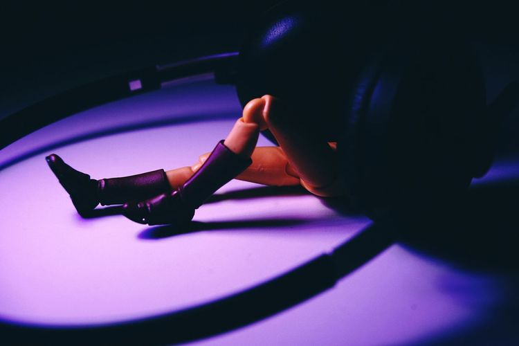 High angle view of woman playing on purple