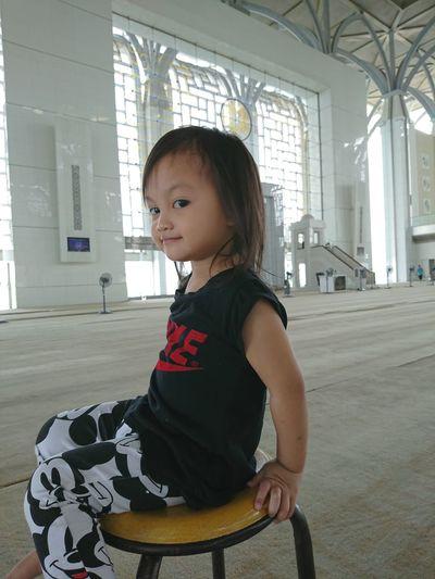 Girl smiling in corridor