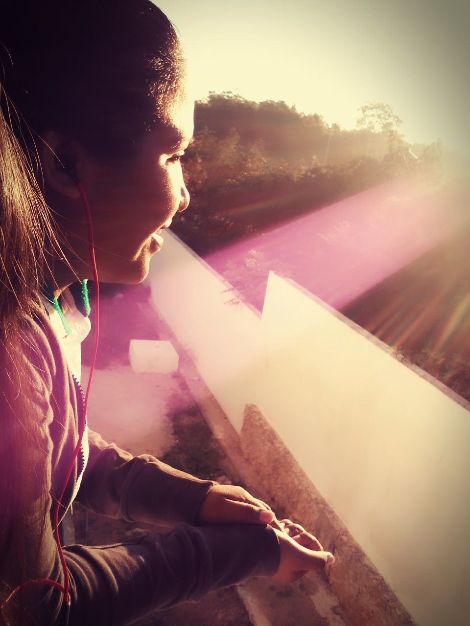 real people, one person, childhood, leisure activity, sunlight, elementary age, outdoors, sunset, day, nature, close-up, sky