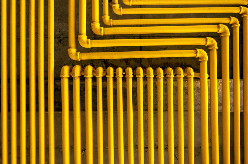 An image of yellow pipes forming an interesting pattern. Abstract Background Backgrounds Bogotá City Colombia Engineering Gas Illustration Industrial Industry Lines Metal Pattern Pipes Steel Tube Tubing Yellow