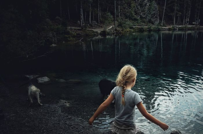 2 Dogs Animal Themes Blond Hair Childhood Day Dog Exploring Forest Full Length Girl Kananaskis Lake Leisure Activity Mountain Addict Mountains Nature Nature One Person Outdoors Rear View Tranquility Water Art Is Everywhere Live For The Story Market Bestsellers 2017