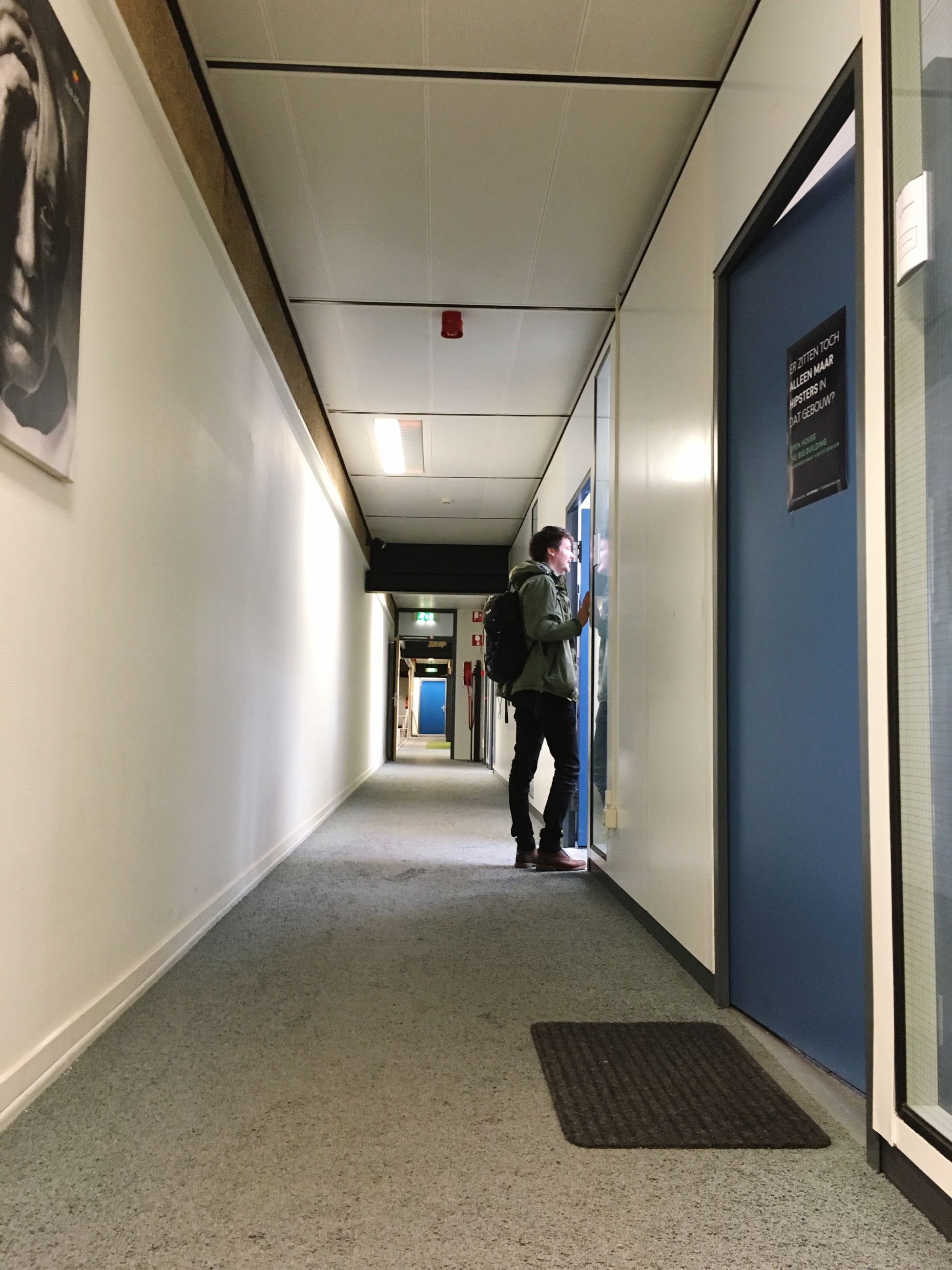 indoors, corridor, the way forward, architecture, built structure, illuminated, walking, men, ceiling, full length, diminishing perspective, rear view, lighting equipment, empty, transportation, narrow, wall - building feature, lifestyles