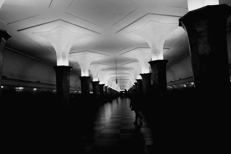 Empty illuminated corridor of building