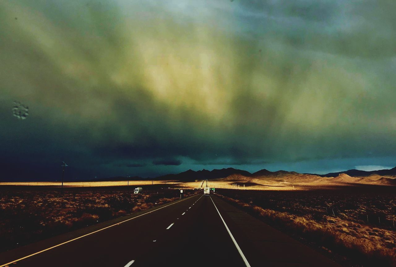 road, the way forward, transportation, road marking, nature, landscape, scenics, sky, outdoors, cloud - sky, tranquility, no people, dividing line, mountain, day, beauty in nature