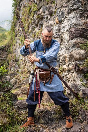 Full length of man holding rock