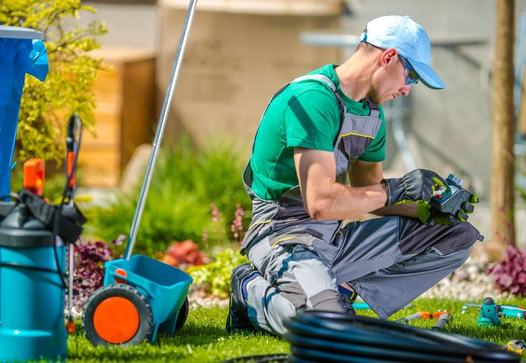Gardener Using Technology At Yard