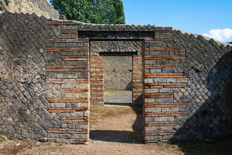 Brick wall with closed door of building