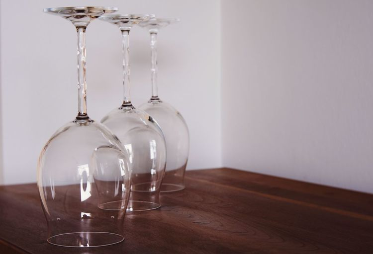 Wine glasses on table against the wall