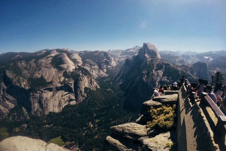 Tourists at observation point visiting yosemite national park on sunny day