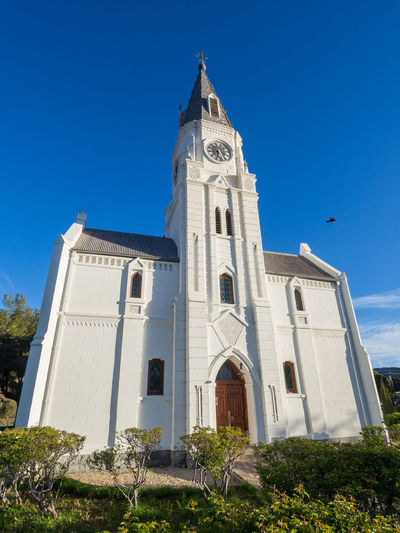 Low Angle View Of White Dutch Reformed Church Against Blue Sky, Nieu-Bethesda, South Africa