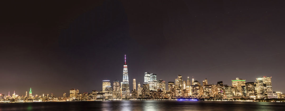 New York City at night from New Jersey shore City City Scape At Night Lights New York City Panorama Skyline At Night Buildings Night No People Structures Urban