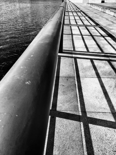 Light and shadow Day Water Outdoors No People Close-up Light And Shadow Lines Shadow Waterfront Handrail  Urban Exploration City Urban Capture The Moment Shadows & Lights EyeEm Best Shots Exceptional Photographs IPhoneography EyeEm Blackandwhite Photography EyeEm Gallery Urban Geometry EyeEm Masterclass City Life The Street Photographer The Street Photographer - 2017 EyeEm Awards