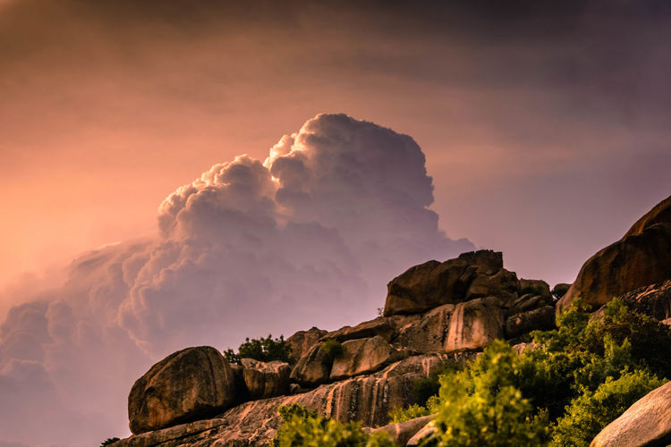 Low Angle View Of Rock Formation Against Sky During Sunset