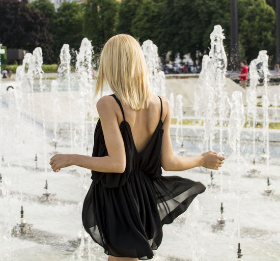 Rear View Of Woman By Water